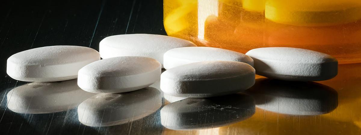 Close-up of prescription pills on table